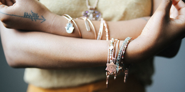 Alex and Ani model wearing Chakra bangles