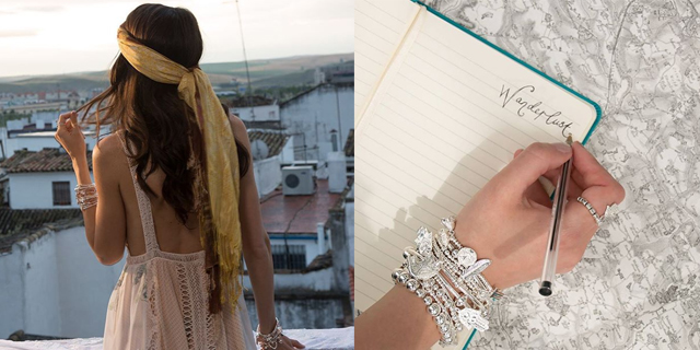 ChloBo model looking at city and hand with bracelets writing wanderlust in a notebook